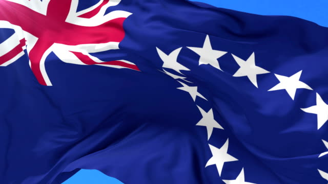 Flag of the Cook Islands waving at wind with blue sky in slow, loop video