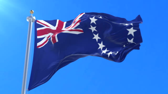 Flag of the Cook Islands waving at wind with blue sky, loop video