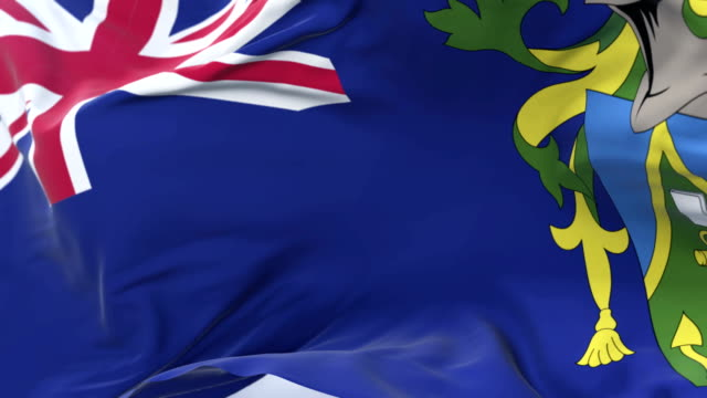 Flag of the Pitcairn Islands waving at wind with blue sky in slow, loop video