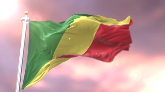 Flag of the Republic of the Congo waving at wind at sunset in slow, loop video