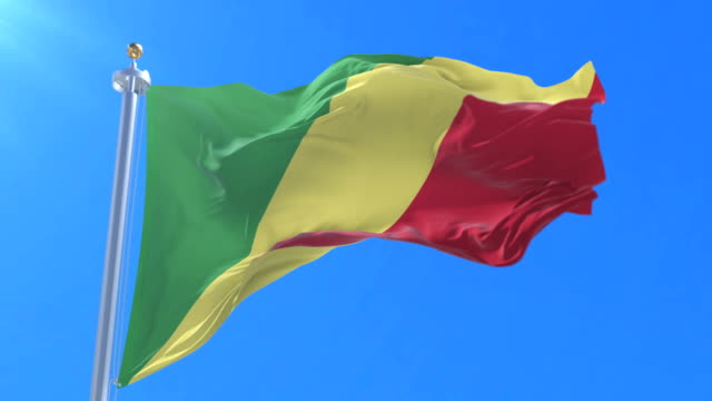 Flag of the Republic of the Congo waving at wind with blue sky in slow, loop video