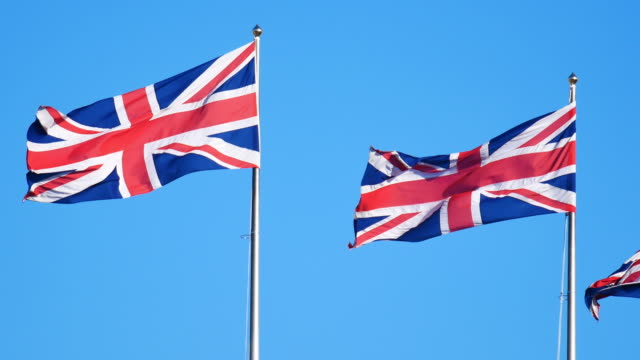 4k flag of the united kingdom, england - england stock videos & royalty-free footage
