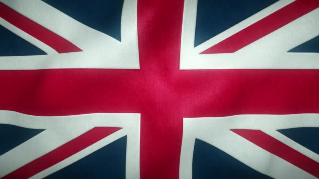flag of the united kingdom waving in the wind - badge video stock e b–roll
