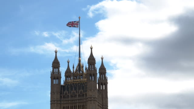 Flag Of The United Kingdom Waving On Houses Of Parliament