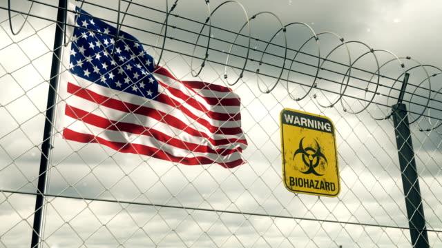 Flagge der Vereinigten Staaten mit Biohazard Zeichen Warnung vor Quarantäne. Loopable. – Video