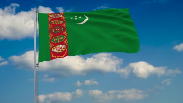 Flag of Turkmenistan against background of clouds floating on the blue sky Flag of Turkmenistan against background of clouds floating on the blue sky turkmenistan stock videos & royalty-free footage