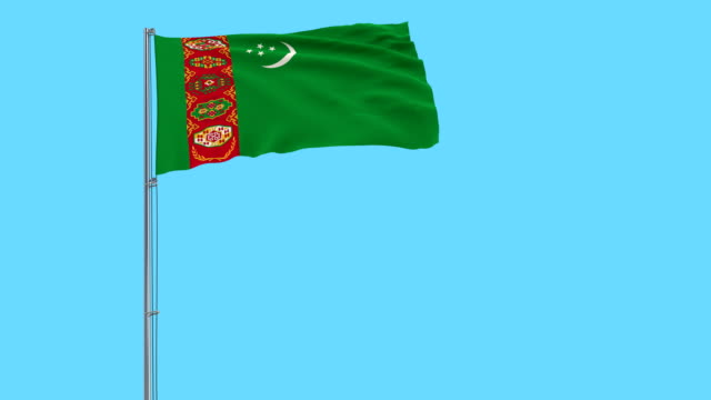 Flag of Turkmenistan on a flagpole fluttering in the wind on a blue background, 3d rendering Flag of Turkmenistan on a flagpole fluttering in the wind on a blue background, 3d rendering turkmenistan stock videos & royalty-free footage