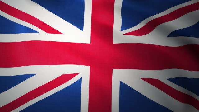 Flag of United Kingdom waving. Sign of UK Union Jack seamless loop waving animation. Great Britain England flag 3D rendering. 4K
