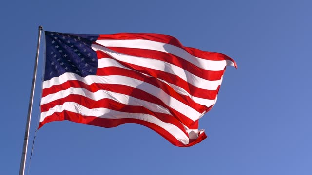 USA flag on flagpole, slow motion. American dream video
