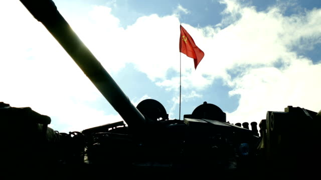 Bидео USSR flag over the silhouette of the Soviet tank