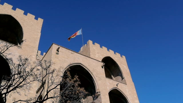 Flag waving on the historical building Valencia, Spain - Stock Video Valencia The Serrans Gate or Serranos Gate, in Spain sorpresa stock videos & royalty-free footage