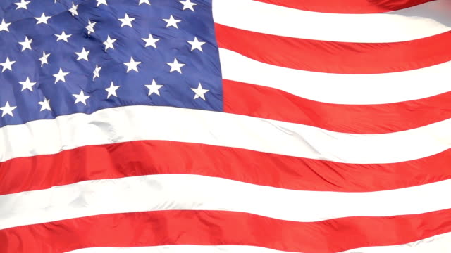 slow motion close up: usa flag waving, representing united states of america - giorno dell'indipendenza video stock e b–roll