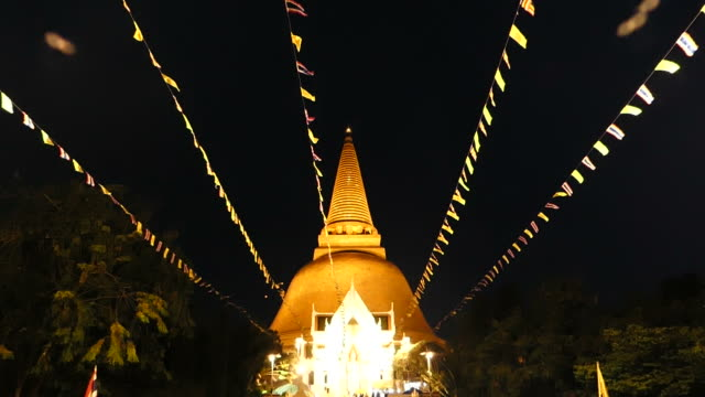 Flags blowing in front of the Golden Stupa video