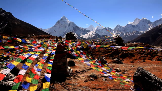 Flags flutter in Himalayas. video