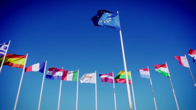 Flags of EU and European countries against the blue sky Flags of European Union and european countries against the blue sky. Smooth slowmotion from a 120 fps original shoot european union currency videos stock videos & royalty-free footage