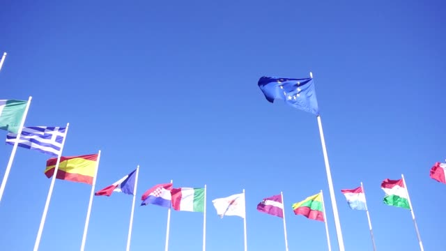 flags of european union countries against the blue sky - страна географический объект стоковые видео и кадры b-roll