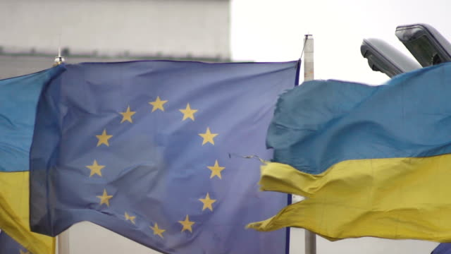 Flags of the European Union and Ukraine are heard in the wind. Slow motion. Close-up Flags of the European Union and Ukraine are heard in the wind. Slow motion. Close-up schengen agreement stock videos & royalty-free footage