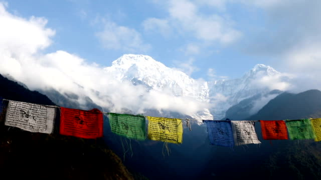 Flags with mantras against the background of the mountains of Nepal Himalayas video
