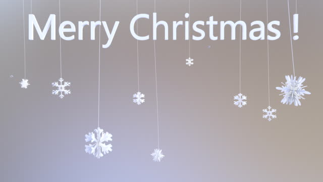 Flakes hanging on strings with Merry Christmas, Luma Matte video