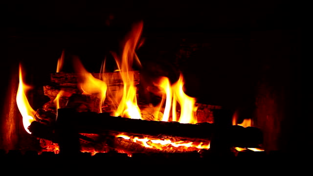 flame in the fireplace Very beautiful flame. Wood burning in the fireplace. fireplace stock videos & royalty-free footage