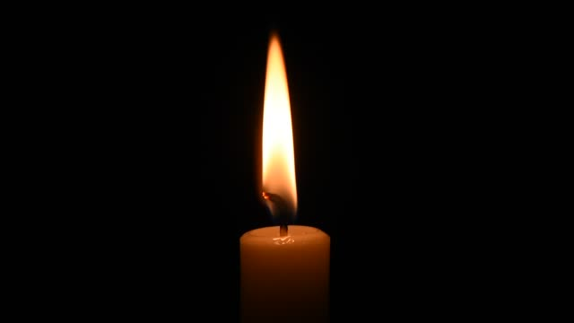 Flame of a candle on a black background Flame of a candle on a black background. Close up candle stock videos & royalty-free footage