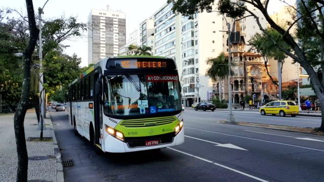 flamengo beach avenue in rio de janeiro - bus stock videos and b-roll footage
