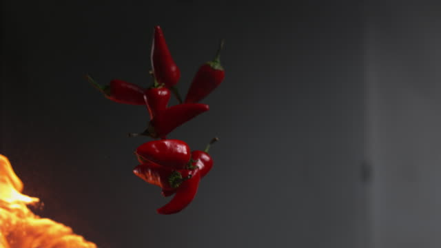 flames and jalapeno peppers - chilli con carne video stock e b–roll