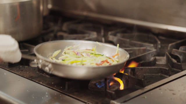 Flames As Chef Pan Sears Vegetables Closeup on pan seared stock videos & royalty-free footage