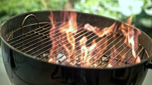 SLO MO R/F Flames of the barbecue grill Slow motion locked down rack focus shot of the flames rising from the barbecue grill. barbecue grill stock videos & royalty-free footage
