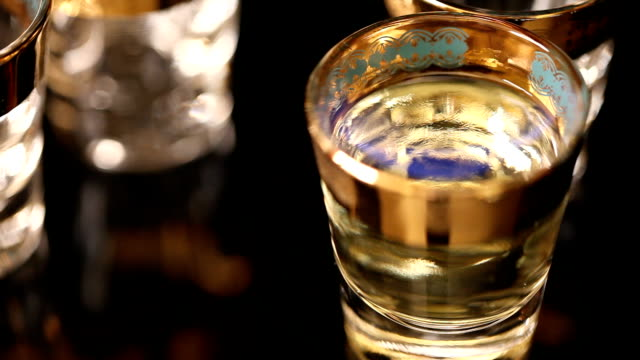 Flaming liqueur with blue flame in shot glass video