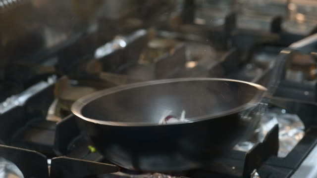 HD Flaming onions in skillet