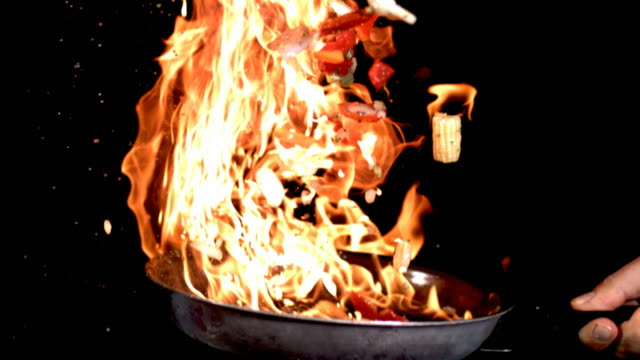 Flaming stir fry, slow motion video