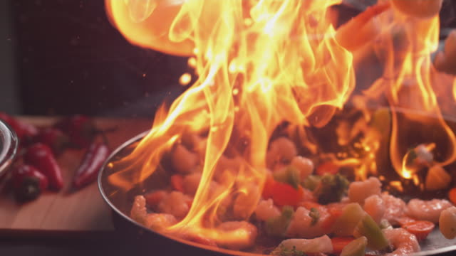 flaming stir fry - chef stock videos and b-roll footage