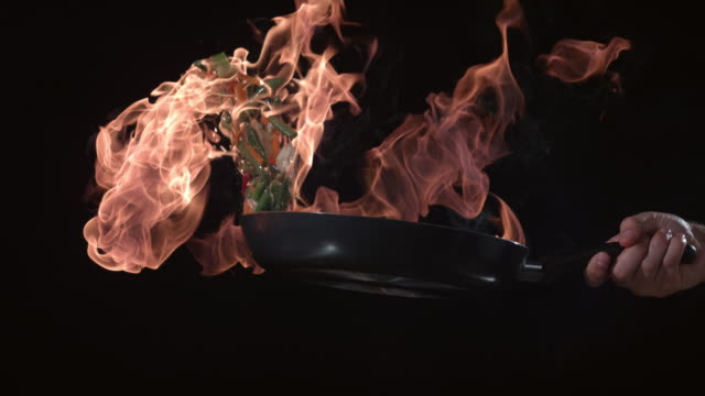 Flaming stirfry in slow motion Flaming stirfry in slow motion; shot on Phantom Flex 4K at 1000 fps stir fried stock videos & royalty-free footage