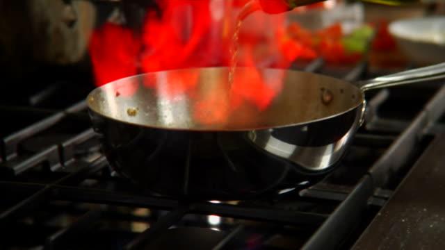 HD Flaming Vegetables in skillet video