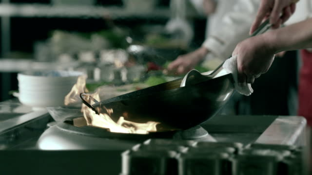 hd flaming vegetables in skillet,slow motion - fine dining stock videos and b-roll footage