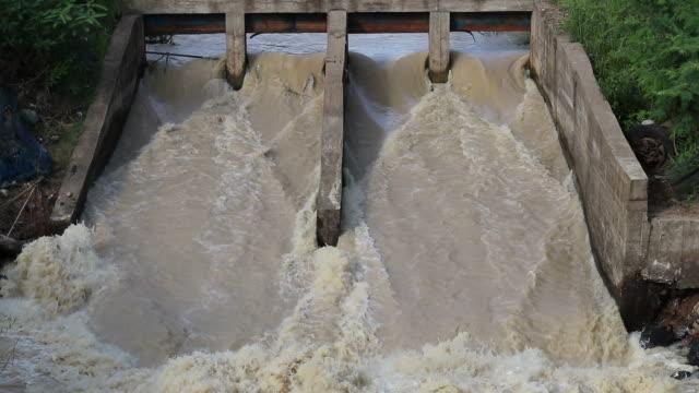 Flash flood through the dam spillway. video