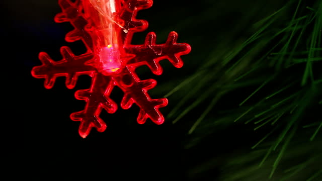 flashing light garlands in the form snowflakes. video