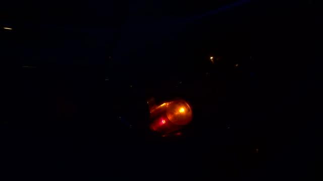 Flashing Orange Blinker Light On Car Parked On Side At Night