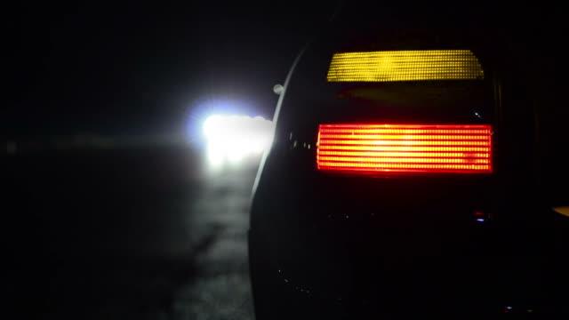 flashing orange blinker light on sport car parked at night - stationär bildbanksvideor och videomaterial från bakom kulisserna