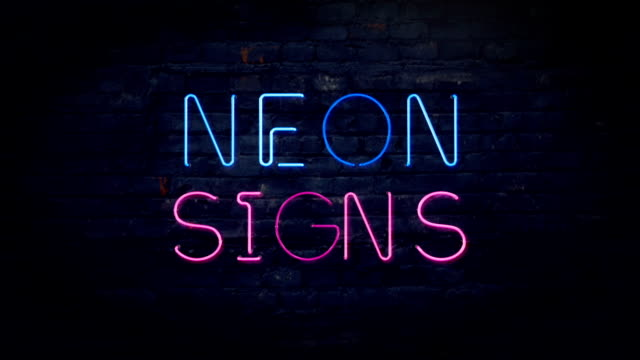 Flashing pink and blue neon sign video