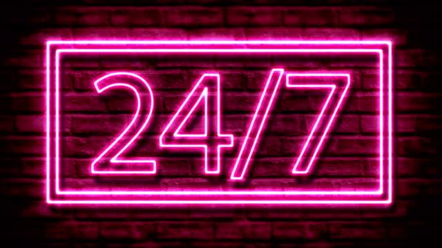 Flashing Sign 24/7 at Brick Wall