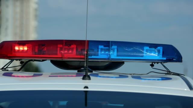 Flashing strobe lights bar on police transport, patrol car crime scene, signal video