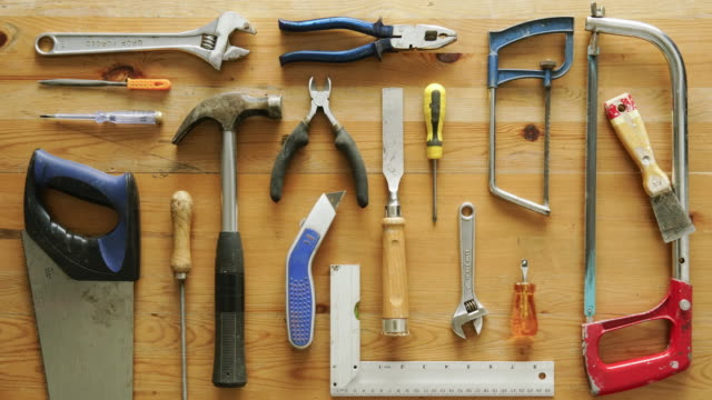 Flat lay hand tools 4K, animated, stop motion stock video of DIY hand tools being laid out on a work bench. table top view stock videos & royalty-free footage