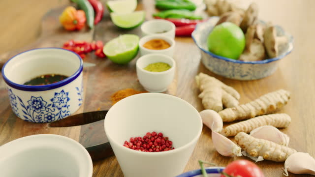 Flat Lay Of Various Vegetables And Spices On Kitchen Counter Dolly shot of various vegetables and spices on counter. Flat lay of fresh healthy food arranged on counter. It is in kitchen. 4K Resolution. ginger spice stock videos & royalty-free footage