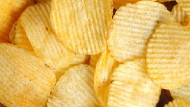 Flavored chips from new potatoes. Flavored crispy chips from new potatoes. Slowly rotate potato chip stock videos & royalty-free footage