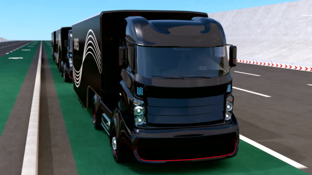 Fleet of autonomous hybrid trucks driving on wireless charging lane Fleet of autonomous hybrid trucks driving on wireless charging lane. 3D rendering animation. independence stock videos & royalty-free footage