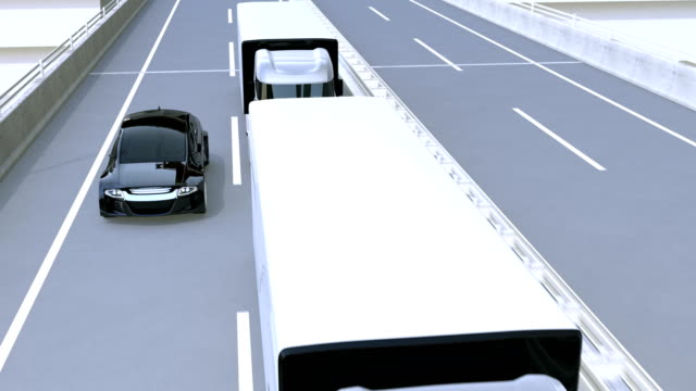 a fleet of autonomous trucks driving on highway - self driving cars stock videos and b-roll footage