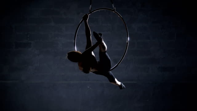 Flexible girl performs a trick on aerial hoop video