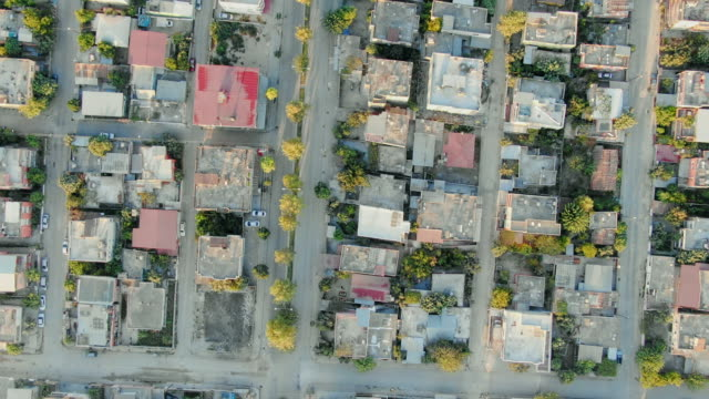 Flight above residential district.  Aerial view from drone of many houses and buildings, urban streets